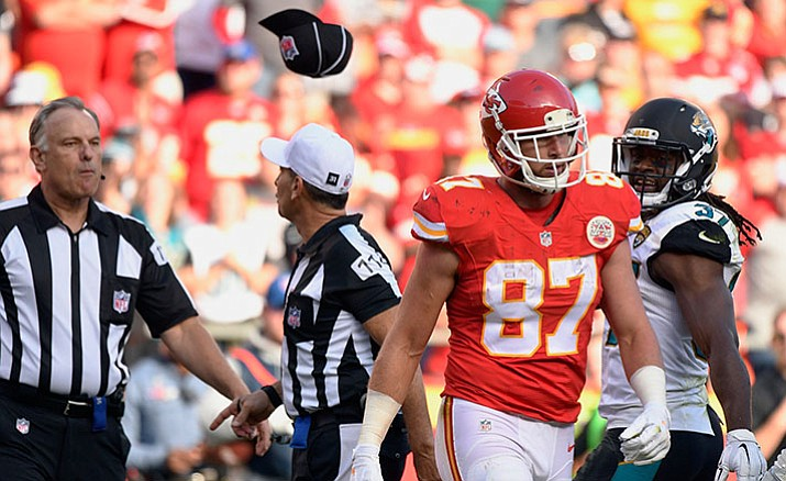 Field Judge Mike Weatherford, left, throws his cap toward Kansas City Chiefs tight end Travis Kelce (87) after Kelce, who was ejected for unsportsmanlike conduct, threw a towel in his direction during the Nov. 6 game against the Jacksonville Jaguars in Kansas City.