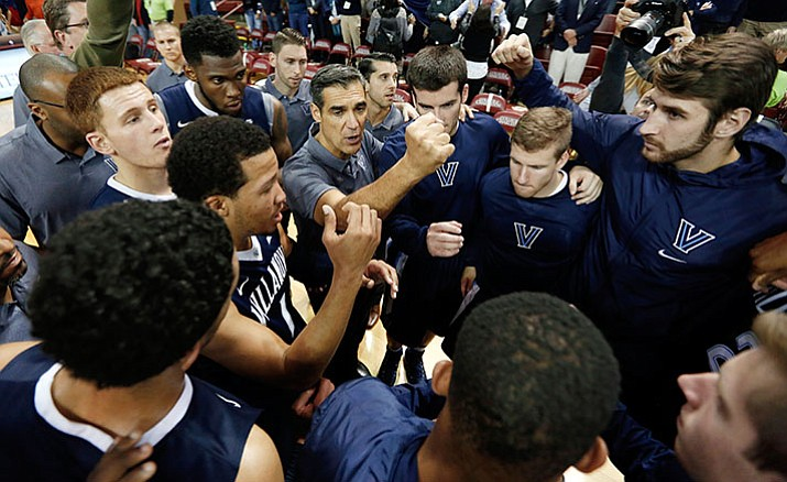 Villanova's head coach Jay Wright, center, huddles his team after they beat Central Florida 67-57 Nov. 20 in the NCAA college basketball game at the Charleston Classic at TD Arena in Charleston, S.C. Villanova starts its fourth week as the No. 1 team in The Associated Press Top 25 released on Monday, Dec. 26.