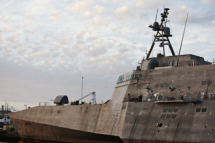 "In this Wednesday, Nov. 30, 2016, photo, the USS Gabrielle Giffords, a Naval littoral combat ship built at the Austal USA shipyards, docked on the Mobile River in Mobile, Ala. The ship is named in honor of former U.S. Rep. Gabrielle ""Gabby"" Giffords of Arizona. Giffords, the former Arizona congresswoman who was shot in the head during an assassination attempt in 2011, helped christen the ship in 2015. It's part of a hotly debated program that congressional critics slam as flawed and too expensive but that Navy leaders defend as a critical new step in naval warfighting."