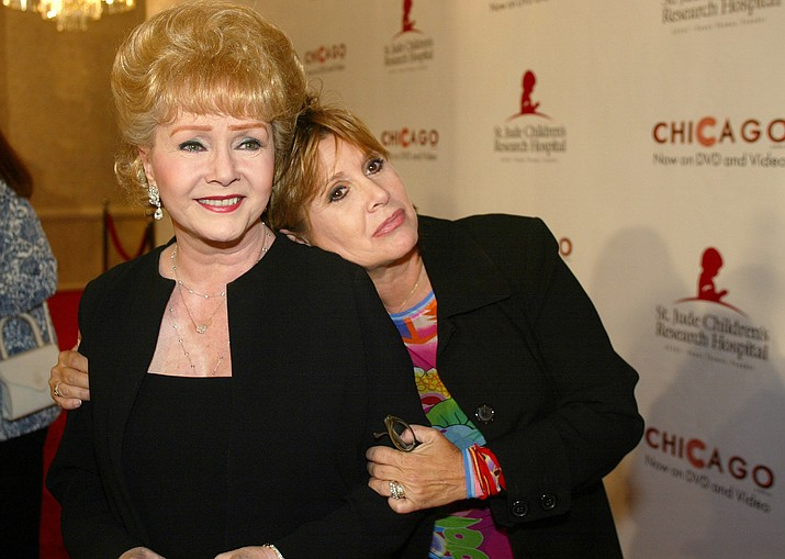 "FILE - In this Tuesday, Aug. 19, 2003 file photo, Debbie Reynolds and Carrie Fisher arrive at the ""Runway for Life"" Celebrity Fashion Show Benefitting St. Jude's Children's Research Hospital and celebrating the DVD relese of Chicago in Beverly Hills, Calif. On Tuesday, Dec. 27, 2016, a publicist said Fisher has died at the age of 60. (AP Photo/Jill Connelly, File)"