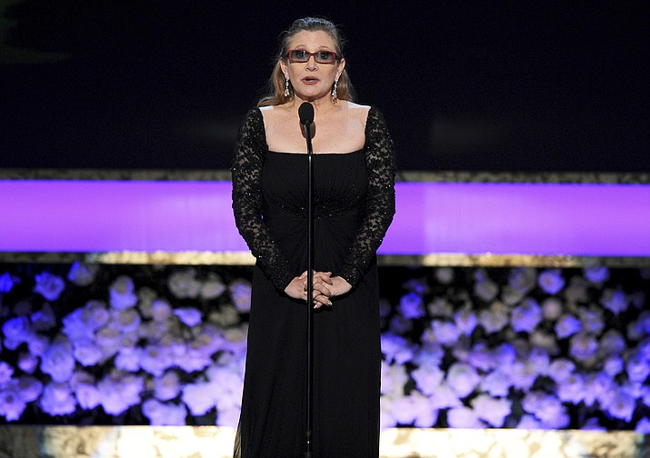 Carrie Fisher presents the life achievement award on stage at the 21st annual Screen Actors Guild Awards at the Shrine Auditorium Jan. 25, 2015, in Los Angeles.