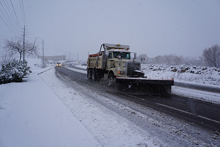 Photo: A city snowplow clears Willow Lake Road on Christmas Eve at about 4 p.m.