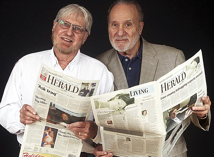 In this September 2015 photo, Bob Wick, left, with his brother, Walter Wick pose for a photo with an issue of the Sierra Vista Herald in Arizona. Walter Wick the former publisher of Arizona's Sierra Vista Herald, who with his brother grew Wick Communications into a media company with publications in 11 states, has died.