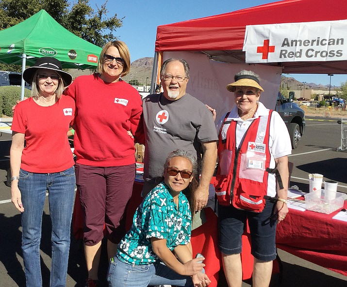 Vern Marschall (second from right) and other Red Cross volunteers at a safety and training event at Kingman Home Depot in April.
