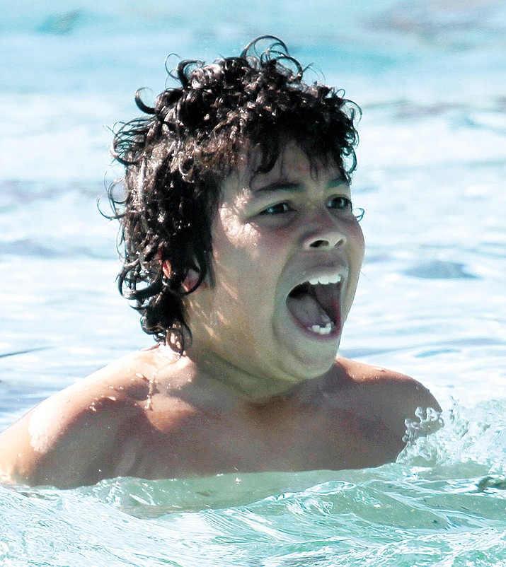 Patrick Hunter, then 11, reacts to the cold water when he took the Polar Bear Plunge in 2013.