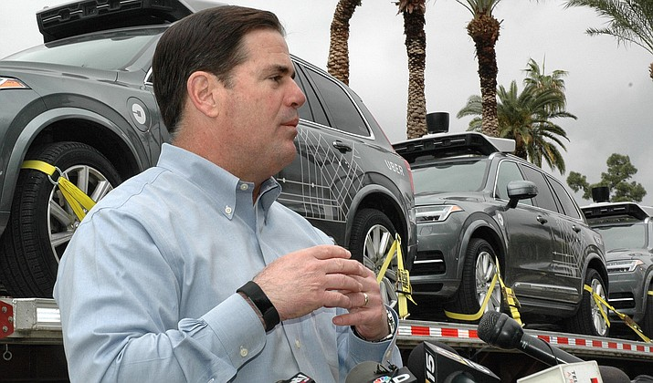 Gov. Doug Ducey welcomes the first of Uber's self-driving cars to Arizona on Friday, insisting there is no danger to public safety from having them tested on state roads. (Capitol Media Services photo by Howard Fischer)