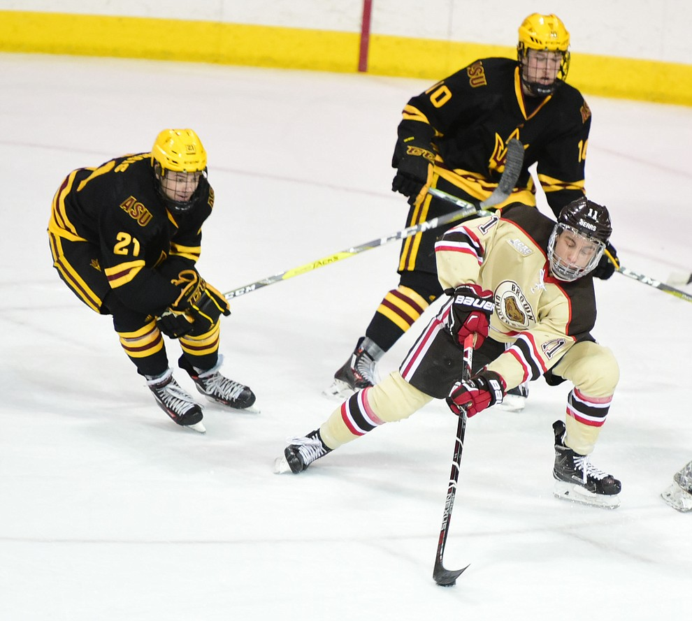Brown's Max Gottlieb controls the puck at center ice as the ASU Sun Devils take on the Brown Bears from Rhode Island  in the Desert Hockey Classic at the Prescott Valley Event Center Friday, December 30. (Les Stukenberg/The Daily Courier)