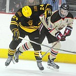 ASU's Liam McGing and Brown's Sam Lafferty battle for the puck as the ASU Sun Devils take on the Brown Bears from Rhode Island in the Desert Hockey Classic at the Prescott Valley Event Center Friday, December 30. (Les Stukenberg/The Daily Courier)