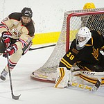 Brown's Zack Pryzbek takes aim on ASU goalie Robert Levin as the ASU Sun Devils take on the Brown Bears from Rhode Island in the Desert Hockey Classic at the Prescott Valley Event Center Friday, December 30. (Les Stukenberg/The Daily Courier)