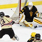 Brown's Brent Beaudoin takes a shot on ASU goalie Robert Levin as the ASU Sun Devils take on the Brown Bears from Rhode Island in the Desert Hockey Classic at the Prescott Valley Event Center Friday, December 30. (Les Stukenberg/The Daily Courier)