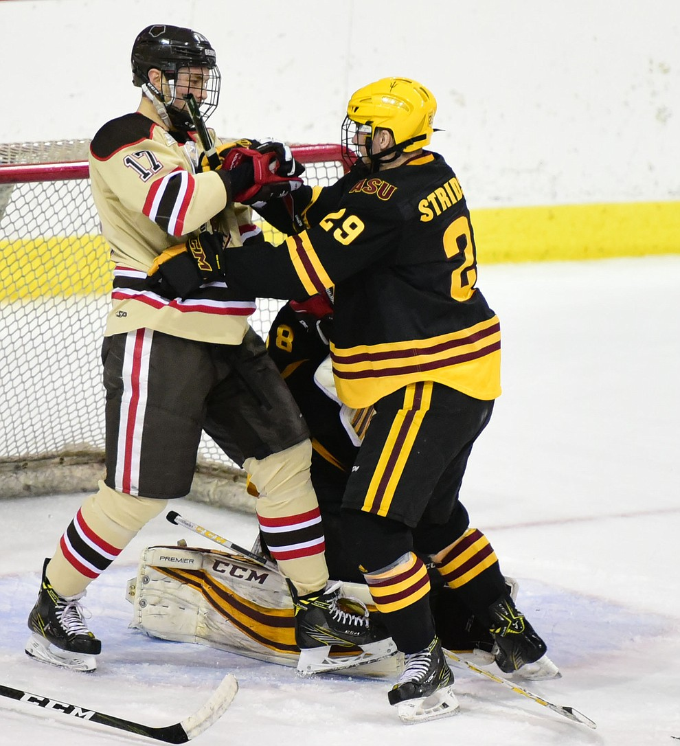 Brown's Zack Pryzbek and ASU's Jakob Stridsberg mix it up as the ASU Sun Devils take on the Brown Bears from Rhode Island in the Desert Hockey Classic at the Prescott Valley Event Center Friday, December 30. (Les Stukenberg/The Daily Courier)