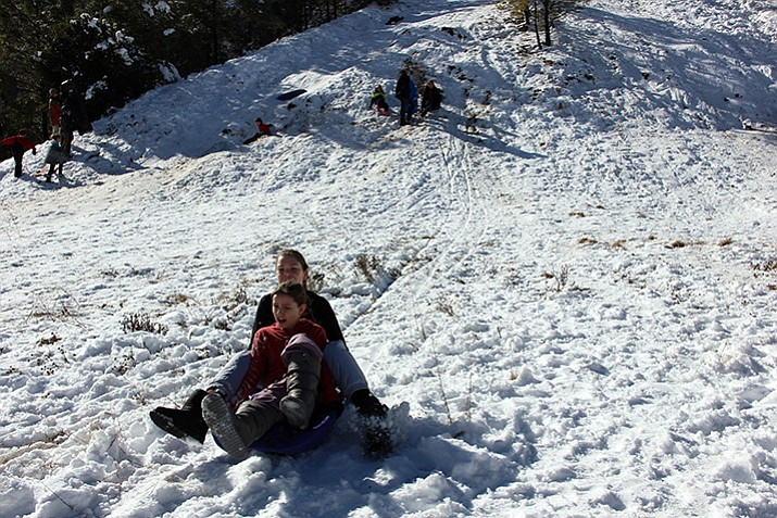 A popular sledding spot along Senator Highway was a busy place this week.