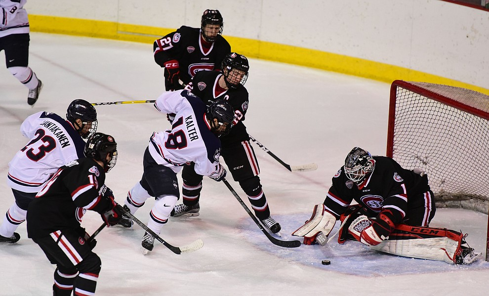 UConn's Max Kalter takes a shot on Jeff Smith as the UConn Huskies take on the St Cloud State Huskies in the Desert Hockey Classic at the Prescott Valley Event Center Friday, December 30. (Les Stukenberg/The Daily Courier)