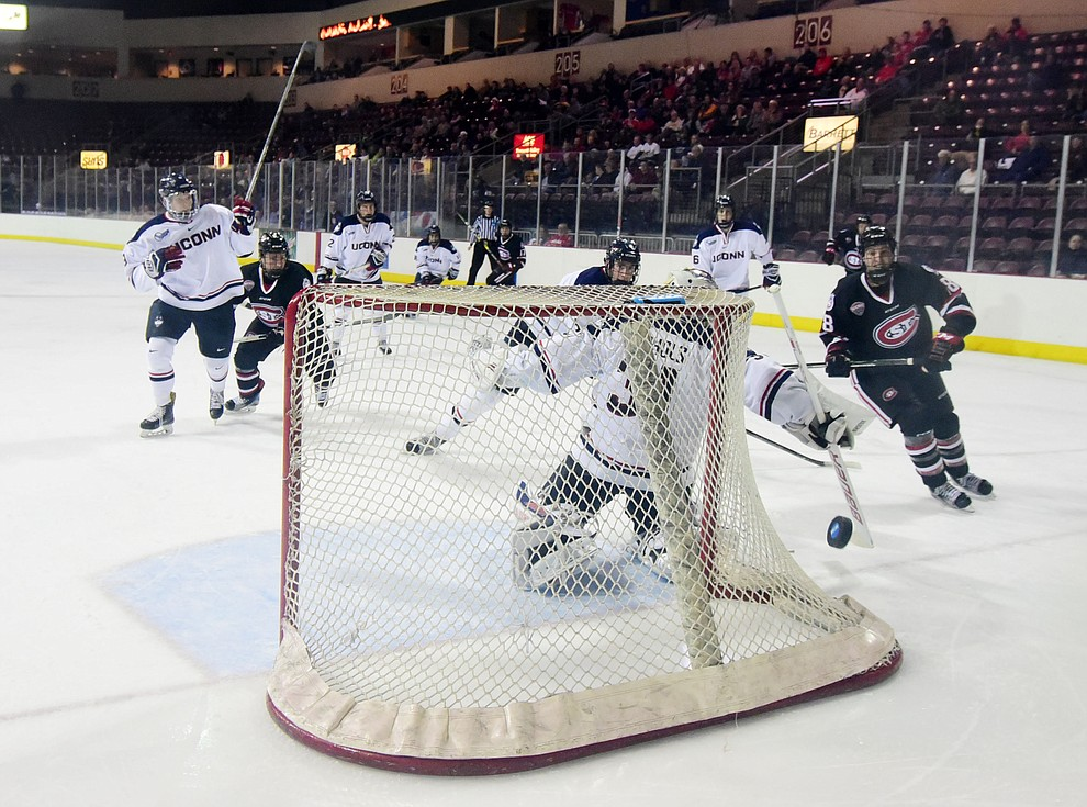 UConn goalie Rob Nichols redirects a shot as the UConn Huskies take on the St Cloud State Huskies in the Desert Hockey Classic at the Prescott Valley Event Center Friday, December 30. (Les Stukenberg/The Daily Courier)