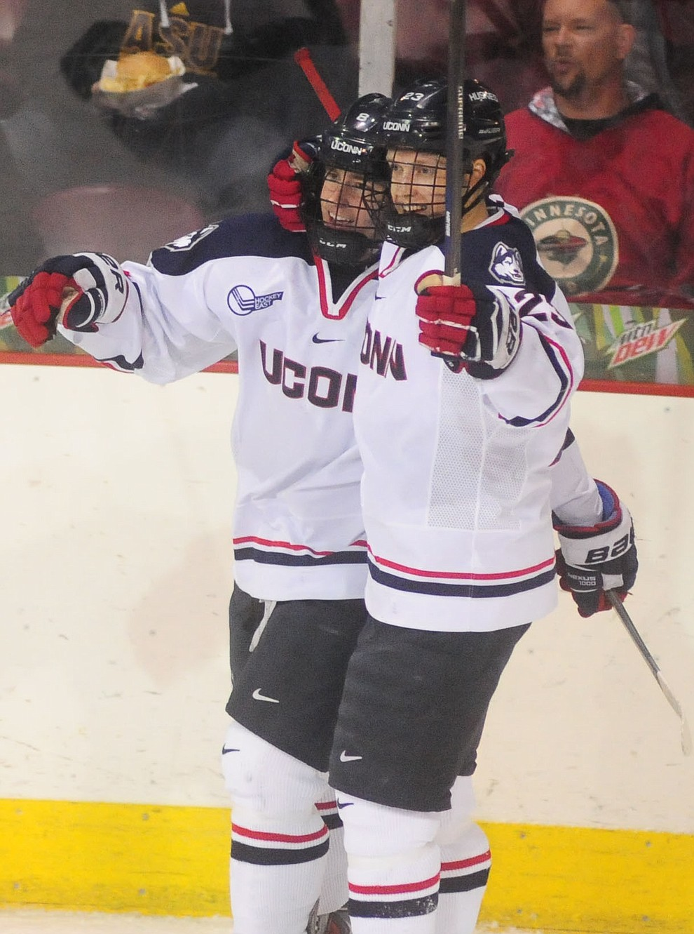 UConn's Spencer Naas and Kasperi Ojantakanen celebrate a goal as the UConn Huskies take on the St Cloud State Huskies in the Desert Hockey Classic at the Prescott Valley Event Center Friday, December 30. (Les Stukenberg/The Daily Courier)