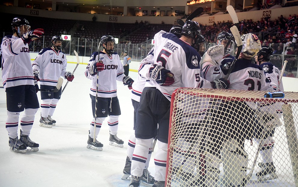 UConn players celebrate their win over the St Cloud State Huskies in the Desert Hockey Classic at the Prescott Valley Event Center Friday, December 30. (Les Stukenberg/The Daily Courier)