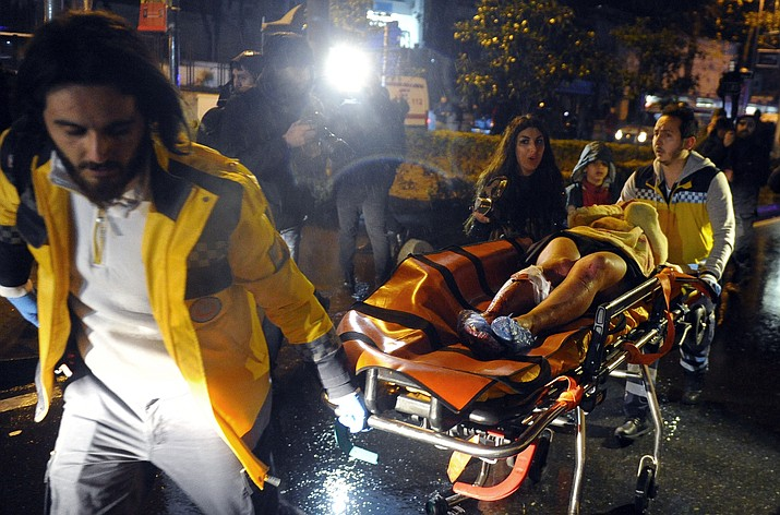 Medics carry a wounded person at the scene after an attack at a popular nightclub in Istanbul, early Sunday, Jan. 1, 2017. Istanbul Governor Vasip Sahin said that an armed assailant has opened fire at a nightclub in Istanbul during New Year's celebrations. Turkish authorities have banned distribution of images relating to the Istanbul attack within Turkey.