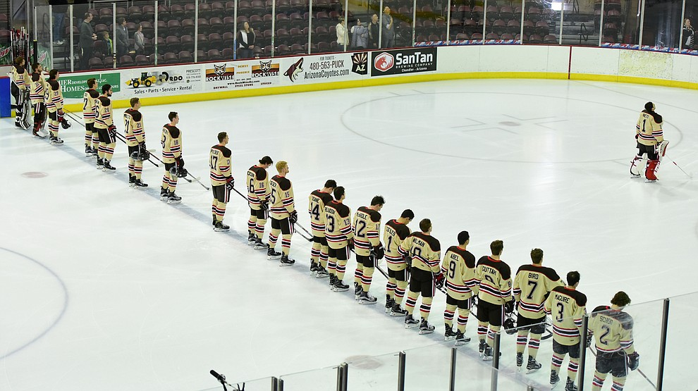 The Bears from Brown University stand for the National Anthem as they take on the UConn Huskies in the championship match of the Desert Hockey Classic at the Prescott Valley Event Center Saturday, December 31. (Les Stukenberg/The Daily Courier)