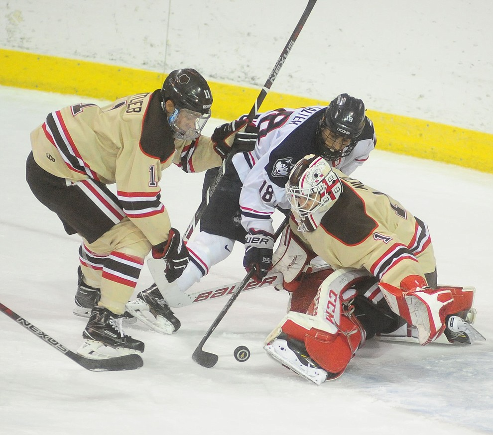 UConn's Max Kalter tries to force the puck pass Gavin Nieto as the Bears from Brown University take on the UConn Huskies in the championship match of the Desert Hockey Classic at the Prescott Valley Event Center Saturday, December 31. (Les Stukenberg/The Daily Courier)