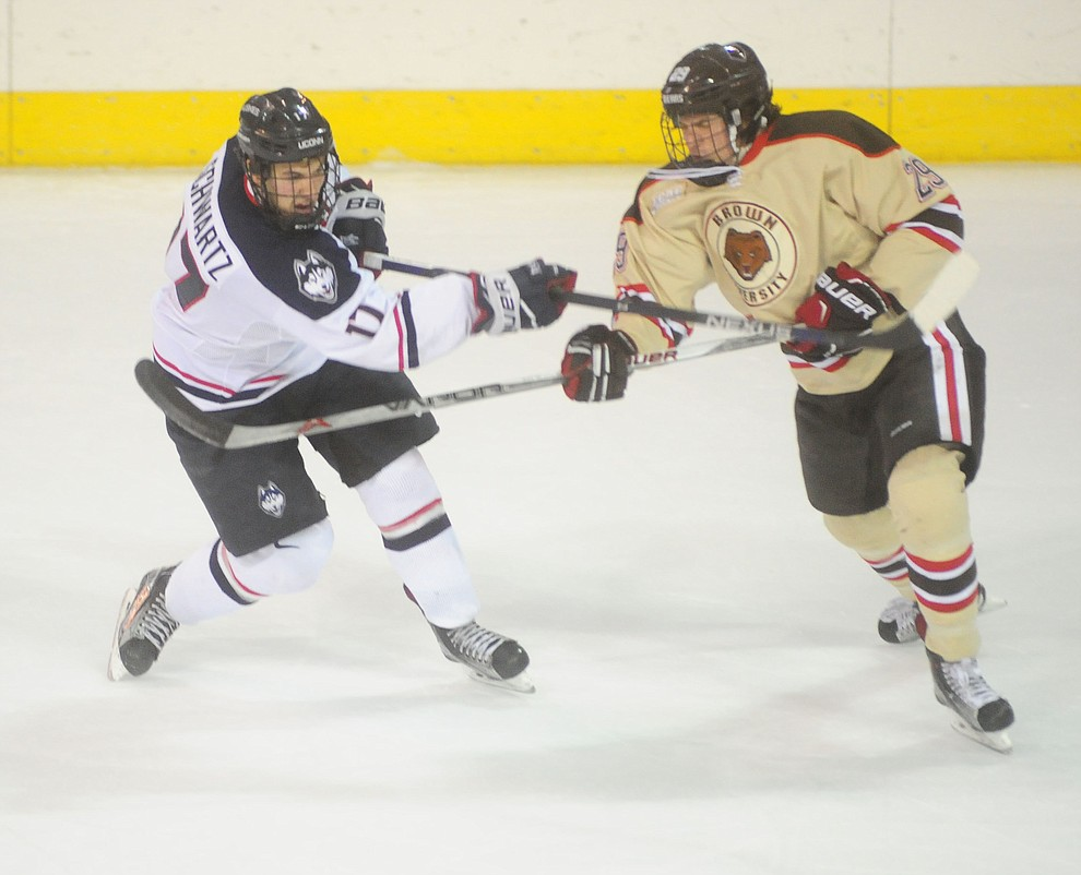 UConn's Jesse Schwartz takes a shot past Brown's Conner Wynne as the Bears from Brown University take on the UConn Huskies in the championship match of the Desert Hockey Classic at the Prescott Valley Event Center Saturday, December 31. (Les Stukenberg/The Daily Courier)
