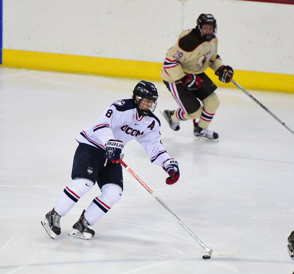 UConn's Spencer Naas brings the puck up ice as the Bears from Brown University take on the UConn Huskies in the championship match of the Desert Hockey Classic at the Prescott Valley Event Center Saturday, December 31. (Les Stukenberg/The Daily Courier)