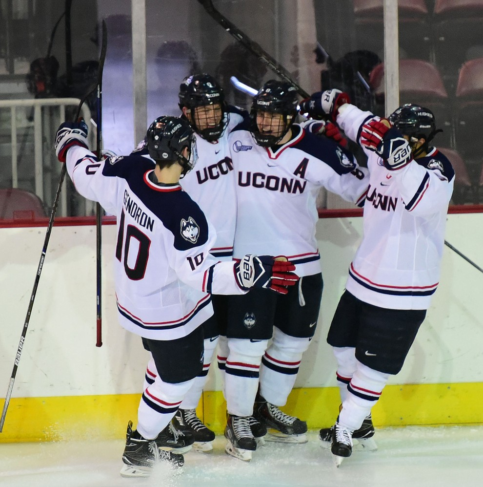 UConn's players celebrate Spencer Naas' second period goal as the Bears from Brown University take on the UConn Huskies in the championship match of the Desert Hockey Classic at the Prescott Valley Event Center Saturday, December 31. (Les Stukenberg/The Daily Courier)