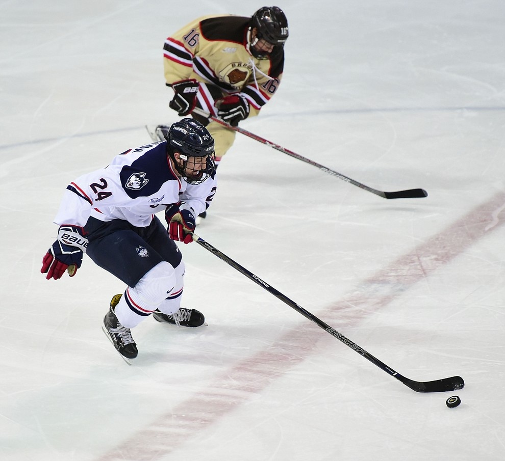 UConn's Benjamin Freeman brings the puck up ice as the Bears from Brown University take on the UConn Huskies in the championship match of the Desert Hockey Classic at the Prescott Valley Event Center Saturday, December 31. (Les Stukenberg/The Daily Courier)