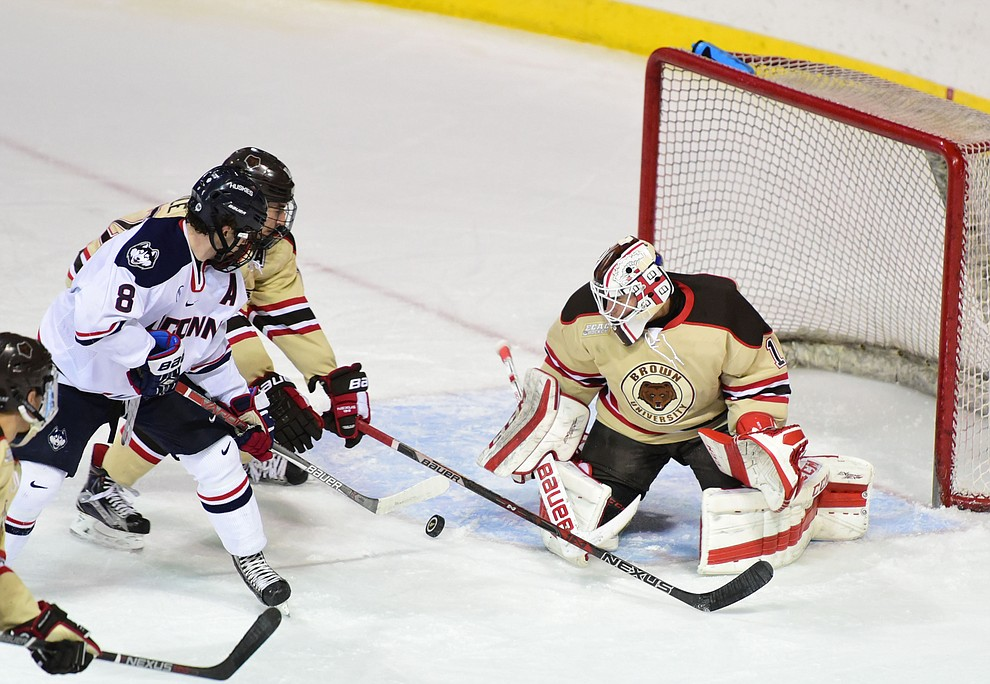 UConn's Spencer Naas puts pressure on Gavin Nieto as the Bears from Brown University take on the UConn Huskies in the championship match of the Desert Hockey Classic at the Prescott Valley Event Center Saturday, December 31. (Les Stukenberg/The Daily Courier)