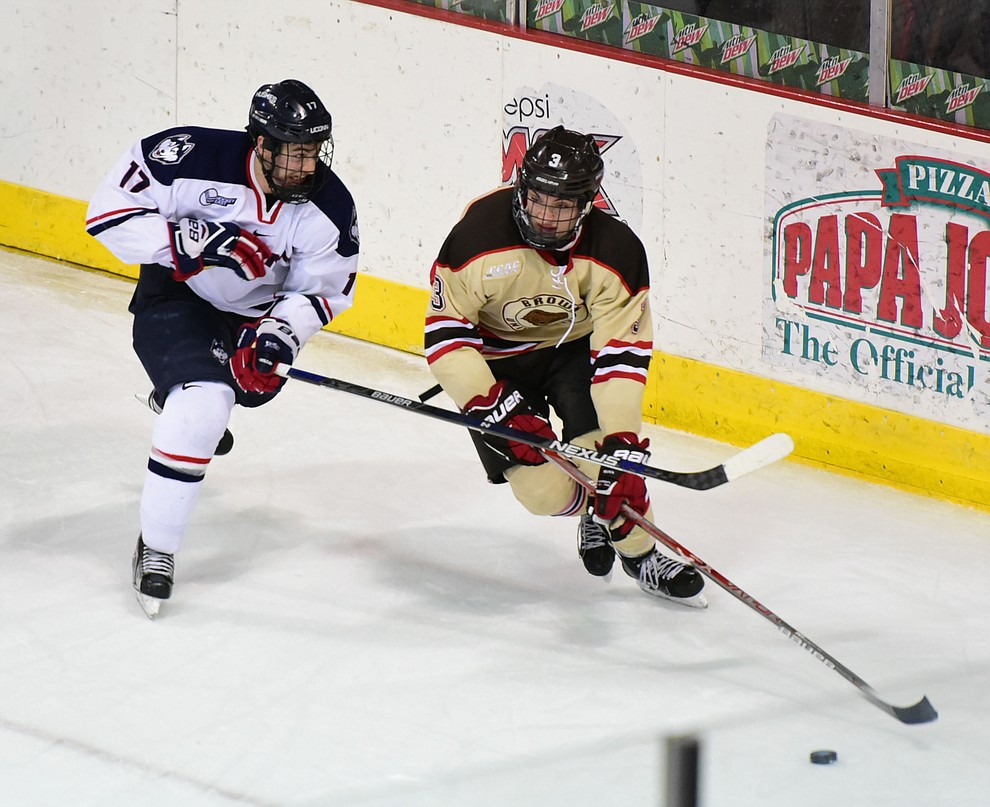 UConn's Jesse Schwartz and Brown's Joe Maguire go for the puck as the Bears from Brown University take on the UConn Huskies in the championship match of the Desert Hockey Classic at the Prescott Valley Event Center Saturday, December 31. (Les Stukenberg/The Daily Courier)