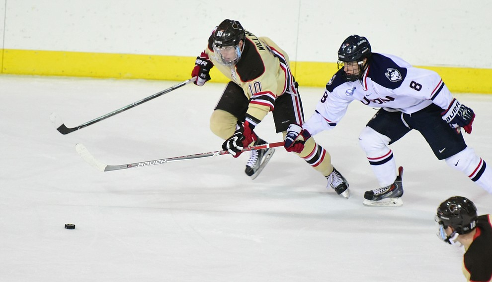 Brown's Max Willman and UConn's Spencer Naas go for the puck as the Bears from Brown University take on the UConn Huskies in the championship match of the Desert Hockey Classic at the Prescott Valley Event Center Saturday, December 31. (Les Stukenberg/The Daily Courier)