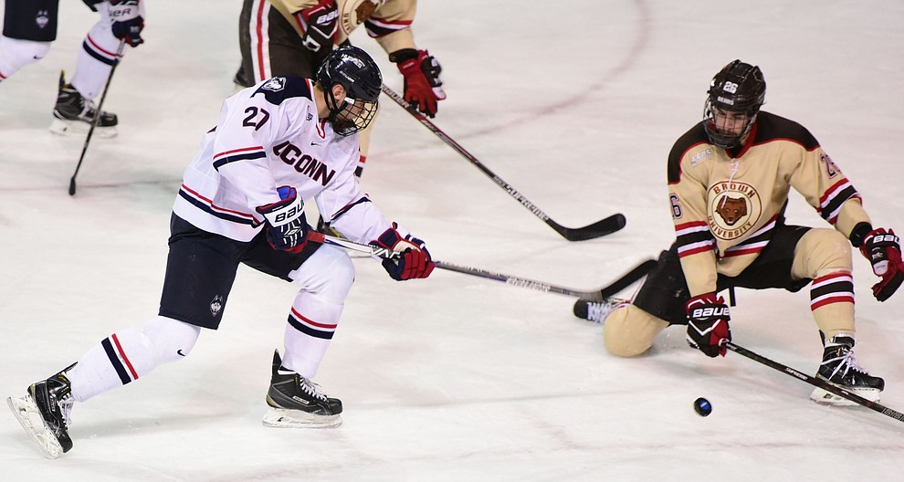 UConn's Maxim Letunov gets a shot blocked by Brown's Tommy Marchin as the Bears from Brown University take on the UConn Huskies in the championship match of the Desert Hockey Classic at the Prescott Valley Event Center Saturday, December 31. (Les Stukenberg/The Daily Courier)