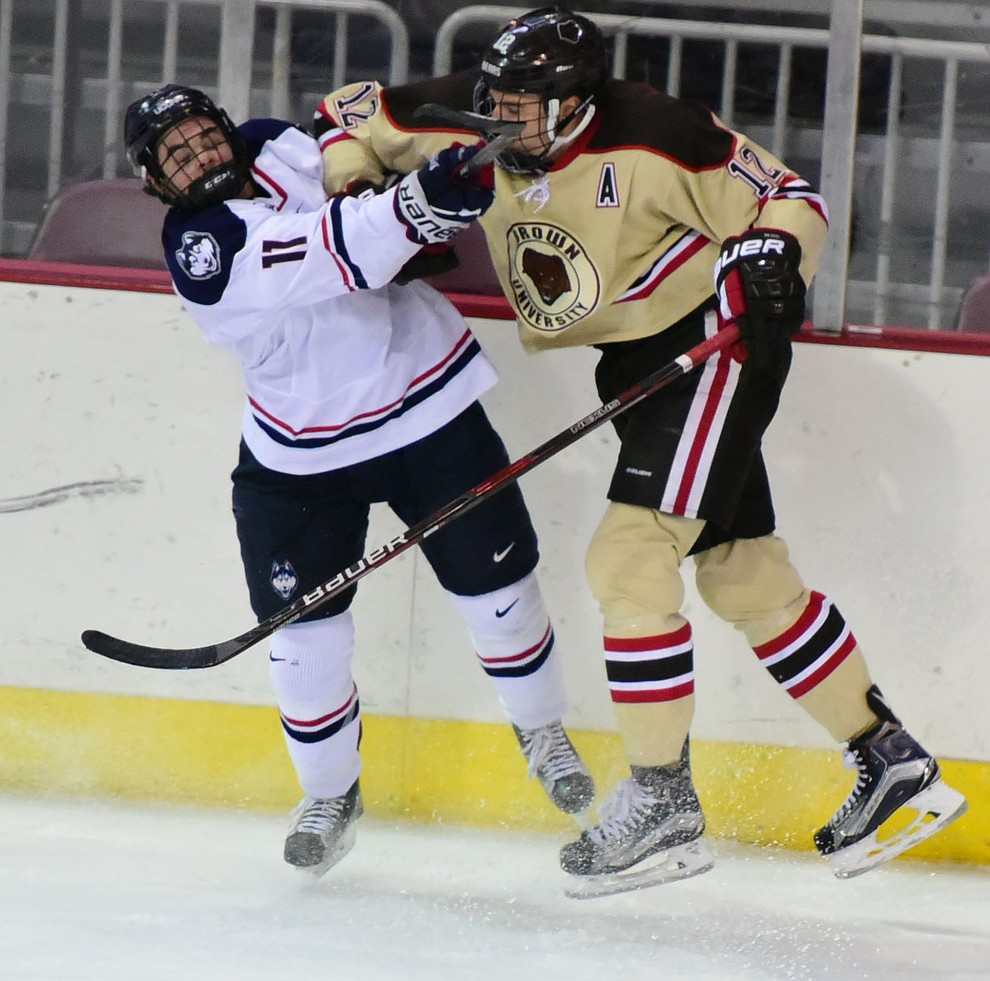 Brown's Corey Ronan gets an elbow from Brown's Josh McArdle as the Bears from Brown University take on the UConn Huskies in the championship match of the Desert Hockey Classic at the Prescott Valley Event Center Saturday, December 31. (Les Stukenberg/The Daily Courier)