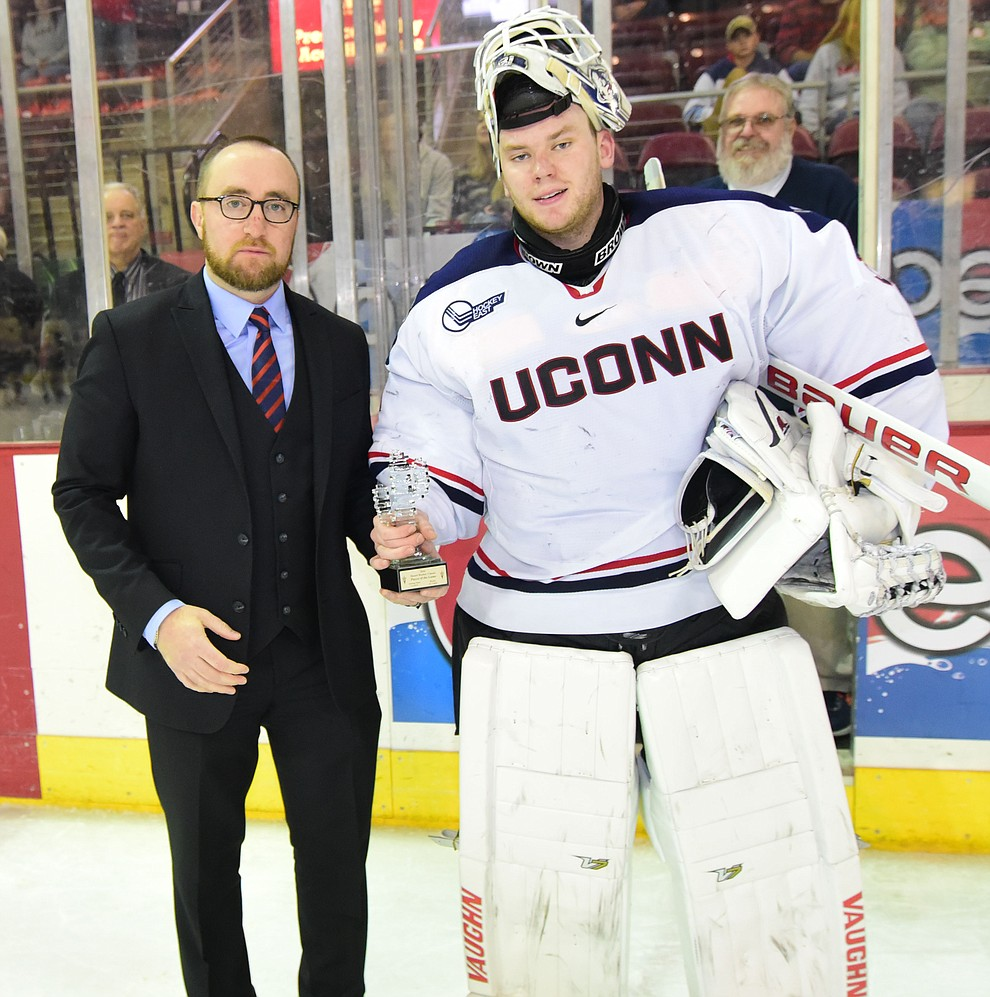 ASU Head Coach Greg Powers presents the team MVP award to UConn goalie Rob Nichols after the UConn Huskies beat the Bears from Brown University in the championship match of the Desert Hockey Classic at the Prescott Valley Event Center Saturday, December 31. (Les Stukenberg/The Daily Courier)