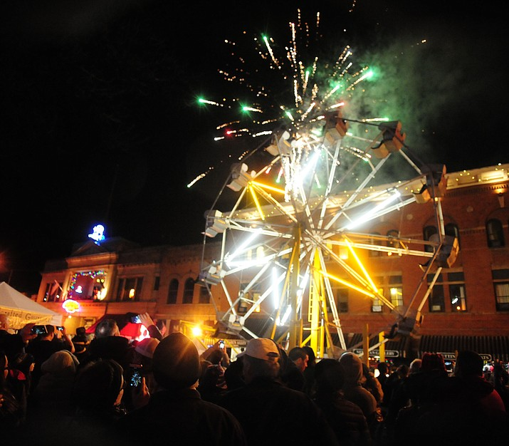 Fireworks erupt from the top of the parking garage at the 6th Annual Whiskey Row Boot Drop in downtown Prescott Saturday, Dec. 31. (Les Stukenberg/The Daily Courier)