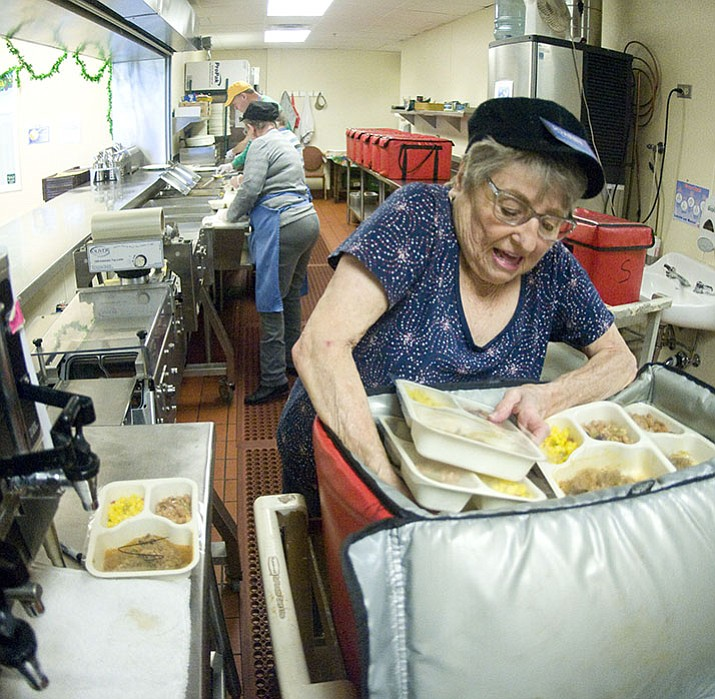 Joann Clay packs up meals for delivery, in March 2015, at the Prescott Meals on Wheels kitchen at the Prescott Adult Center on Rosser Street. Meals on Wheels is a CDBG recipient.