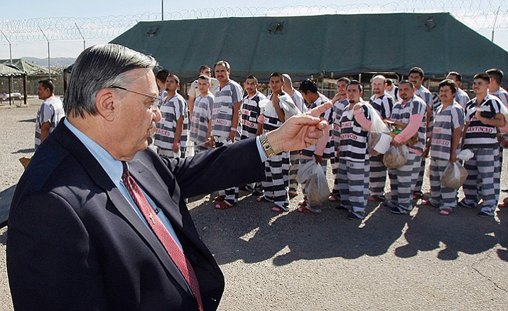 Maricopa County Sheriff Joe Arpaio, left, in 2009 orders approximately 200 convicted illegal immigrants handcuffed together and moved into a separate area of Tent City, in Phoenix, for incarceration until their sentences are served and they are deported to their home countries. Arpaio has left office with a mixed legacy on immigration, jails and other key issues.