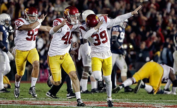 Southern California place kicker Matt Boermeester celebrates after kicking the game-winning field goal against Penn State during the second half of the Rose Bowl NCAA college football game Monday, Jan. 2, in Pasadena, Calif.