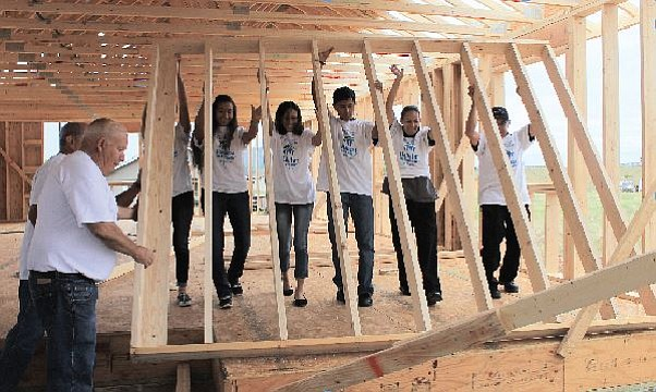 The Hernandez family helps put up a wall in their home in Williams in 2016. Habitat for Humanity in Williams plans to break ground on its fourth home this year.