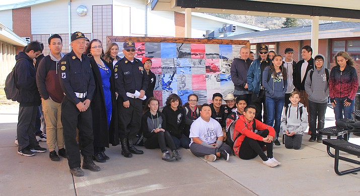 Art students at Williams High School present a painting to the Williams American Legion Cordova Post 13. The students spent the semester creating the painting for the veterans.