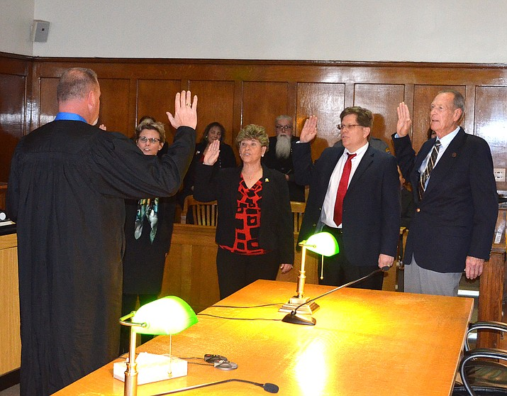 Four Mohave County supervisors returning to the board take their oaths of office. Judge Charles W. Gurtler Jr. (left), swears in (from left to right) Hildy Angius, Jean Bishop, Steve Moss and Gary Watson.