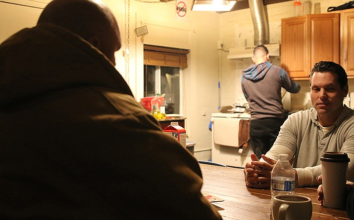 Men wait for breakfast at Recovery in the Pines, a treatment center in Prescott. (Photo by Tyler Boyle/Cronkite News)