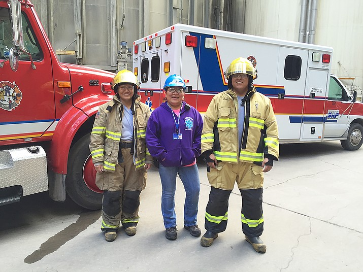 Navajo Generating Station ERT members Germaine Beard, Raelene Beatty and Chris Mallahan participate in an ERT training to advance hose lines to an elevated level Dec. 16. Photo/George Harden