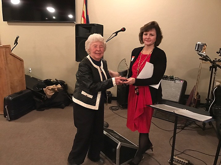 Dawn Knight, left, receives the award from Toni Denis.