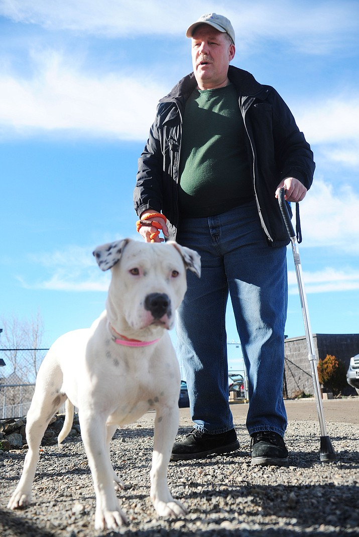 Yavapai Humane Society volunteer Sam Tarhan walks Gypsy at the facility on Sundog Ranch Road in Prescott Wednesday, January 4. (Les Stukenberg/The Daily Courier)