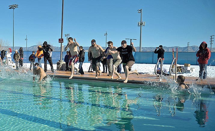 People jump in for Prescott Valley's Polar Bear Plunge in 2015. This year's plunge is scheduled for 10 a.m. Saturday, Jan. 7.