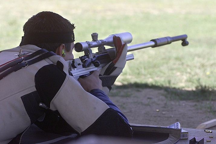 Chris Abalo from Glendora, Calif., in August 2003 takes aim in the Arizona Small Bore Championship at the Prescott Sportsmen's Club, off Iron Springs Road near Granite Basin.