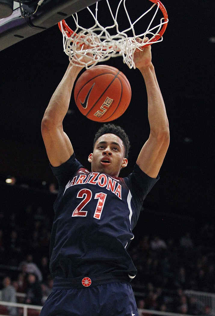 Arizona's Chance Comanche dunks against Stanford during the first half Jan. 1 in Stanford, Calif.