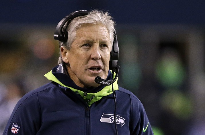 Seattle Seahawks head coach Pete Carroll looks on from the sidelines against the Los Angeles Rams in the first half of an NFL football game, Thursday, Dec. 15, 2016, in Seattle. (AP Photo/Elaine Thompson)