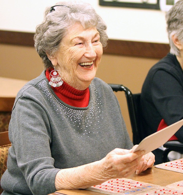 Pat Kaminski reacts with delight to winning Blackout Bingo Saturday at White Cliffs Senior Living Saturday morning. Kingman is a top-rated city for senior living standards.
