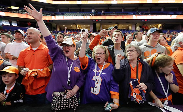 Clemson fans cheer during media day for the NCAA college football playoff championship game against Alabama Saturday, Jan. 7, in Tampa, Fla.